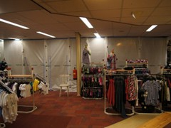 Protect retail merchandise during store renovation or installing new marketing displays with the Curtain-Wall® temporary wall system.